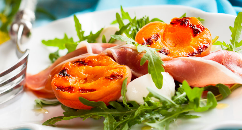Grilled Apricots with Burrata, prosciutto and Arugula